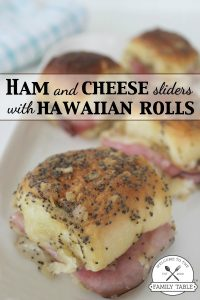 Make these delicious ham and cheese sliders on Hawaiian rolls for your next gathering and your guests won't get enough! :: welcometothefamilytable.com