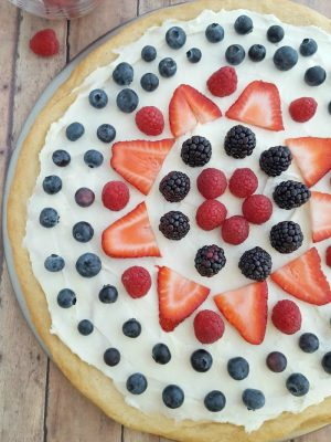 This Red White + Blue Fruit Pizza is perfect for the 4th of July or any other gathering!